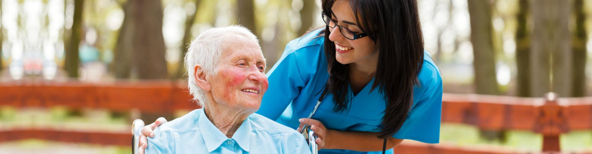senior woman and her female nurse